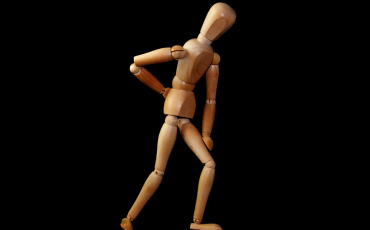 Wooden mannequin with arm on back