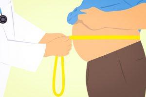 Cartoon of doctor measuring person's waist