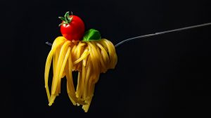Spaghetti on a fork with a tomato on top
