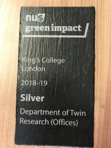 Plaque awarding the department of twin research a silver sustainability award
