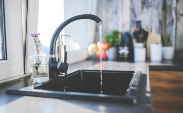 Tap with running water into sink