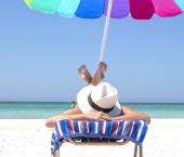 Person sunbathing on beach